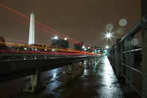 Washington Monument in Rain at Night with logo